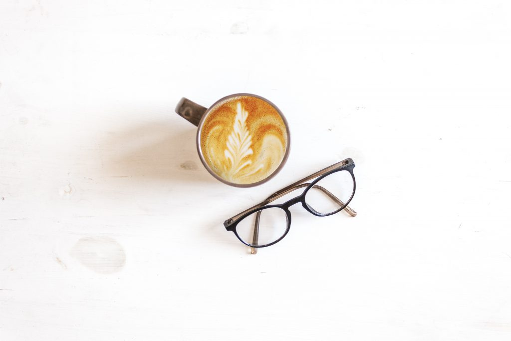 a delicious cup of coffee and a pair of glasses: positive visualisation